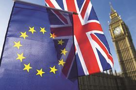 Union Jack and EU flag in front of Palace of Westminster
