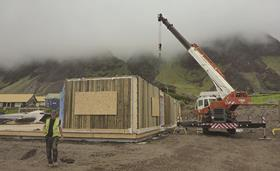 Timber wall panels being erected. These include preinstalled triple-glazed windows