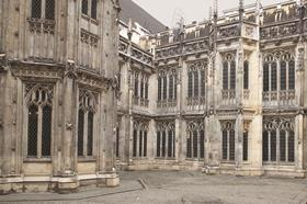 Dilapidation of stonework in cloister court