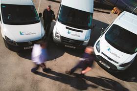 Three vans branded with Carillion logo