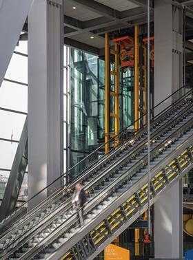 The two banks of escalators whisk visitors to two elevated lobbies above the tower's now public space