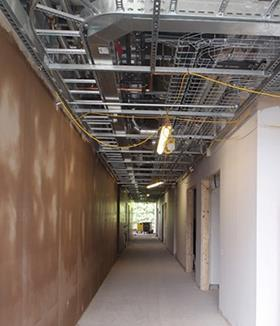 Prefabricated services decks are slotted into the corridor ceiling spaces