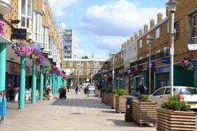 Shops and homes on Market Way at Chrisp Street Market in east London