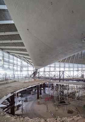 A large opening in the first and second floors allows people to appreciate the architecturally striking roof from ground floor level. These slabs are being replaced with floors with a smaller opening and more generous floor to ceiling heights