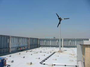 In built up areas, wind turbines are often located on top of buildings