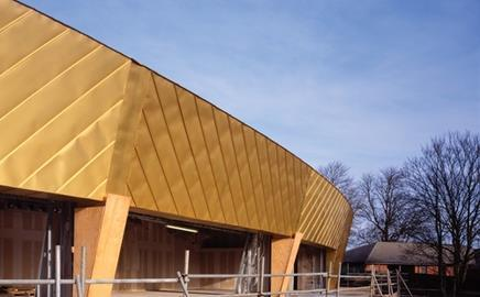 Richardson Roofing, the company responsible for the arts centre's gold-coloured roof, walked off the project at the end of last year
