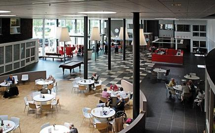 A generous hub accommodates a buzz of social activities at the Maartenshof care centre in Groningen in the Netherlands