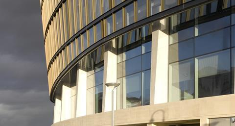 The exterior precast columns were made from white acid-etched reinforced concrete to give an attractive Portland stone-like finish