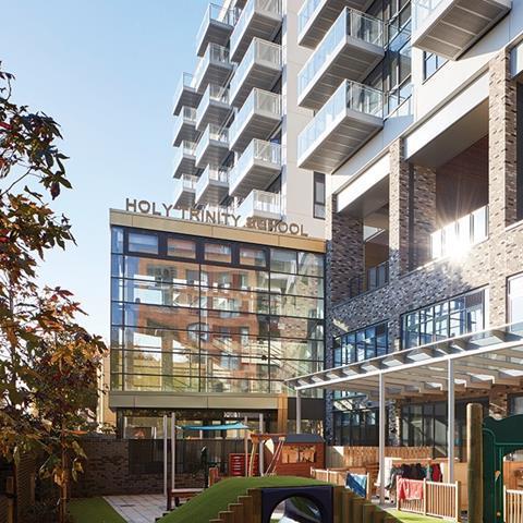 The new school sits below storeys of flats