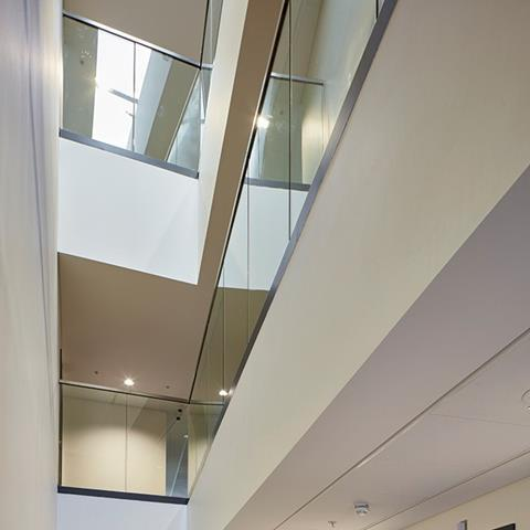 The third-level deck allows rooflights to permeate into the centre of the deep-plan interior