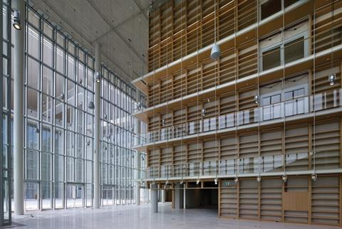 The library foyer features full-height glazing and bookcases