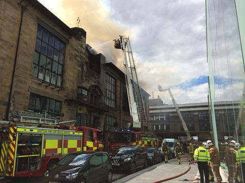 Firefighters tackle the blaze at the Mac