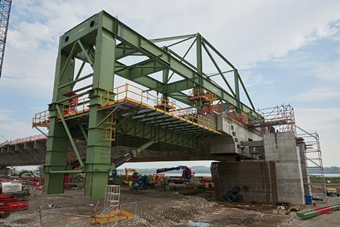 The cantilever wing traveller is used to construct the cantilevered outer wings of the viaduct deck