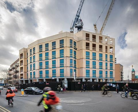 The development consists of a six-storey residential block, a four-storey office and a 10-storey residential tower, which will be the tallest CLT building in the world when it completes later this year. The scheme sits on a concrete podium, needed for the